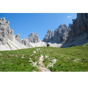 The Perugini Bivouac stands in the center of a glacial circus, at the very top of the Montanaia Valley